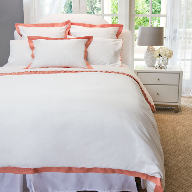 http://www.craneandcanopy.com/products/the-linden-coral-border-duvet-cover?gclid=CICRk5DHhrYCFRCf4Aod12UA2w